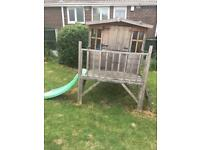 Wooden play house with slide