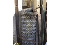 Galvanised steel chain link fencing.