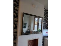 Large wall mirror with black and gold antique finish frame