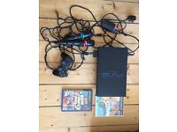 Sony PS2 with games, controller, pair of mics and a memory card