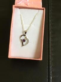 Ladies pendant with a amethyst stone and chain marked 925