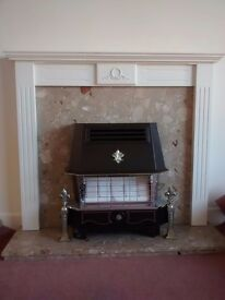 Fire surround with conglomerate marble hearth and back panel