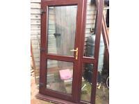 Brown upvc back door including glass