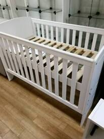 Cot bed in white can be adjustable raise and lower