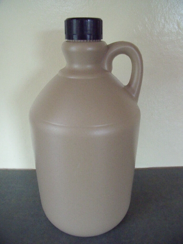 2.4 litres stone-coloured plastic beer/cider flagon/bottle with integral handle and black screw lid.