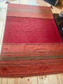 Large woven rug - mixed red / orange colours 90 x 61 inches