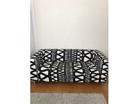 IKEA couch. Great condition with unique black and white print cover