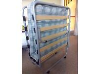 Folding single bed for guests. Metal frame on wheels for easy movement. Includes mattress. Like new