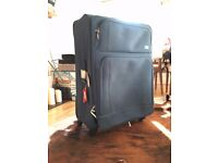 Delsey large softcase with 4 weels. 77 x 51 cm (damaged)
