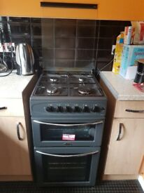 Black gas cooker and fridge freezer