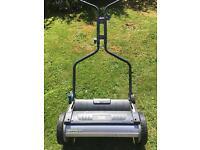 Push along lawnmower