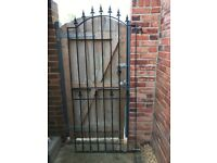 Iron garden gate with all hinges