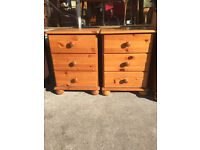 Pair of pine bedsides , 3 drawers in each unit , bun feet .
