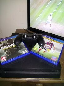 Ps4 slim 500gb boxed 2 games 1 control earphones hardly used