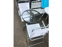 Garden table and 2 folding chairs
