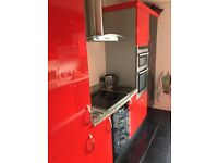 FITTED HIGH GLOSS RED / BLACK KITCHEN UNITS AND SOME APPLIANCES IN EXCELLENT CONDITION
