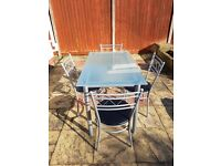 Glass dining set with 4 chairs.