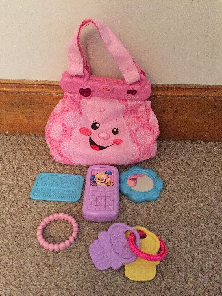 Fisher Price Musical Laugh and Learn My Pretty Learning Purse.