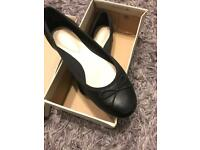 Black Clark's shoes size 2