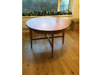 Oak table, round, modern design, seats four.