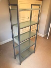 Free standing metal framed glass shelf unit