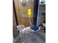 Glass topped bar table and stools
