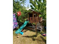 Wooden Playhouse on stilts with slide