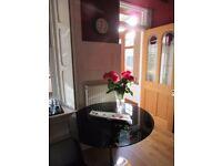 1 metre diameter beautiful black glass table for sale