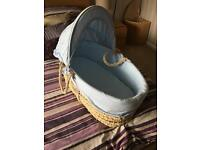 Moses basket with 11 used sheets and 2 brand new.
