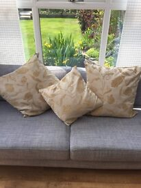 Gold/brown floral cushions - set of three