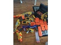 Collection of nerf guns and bullets