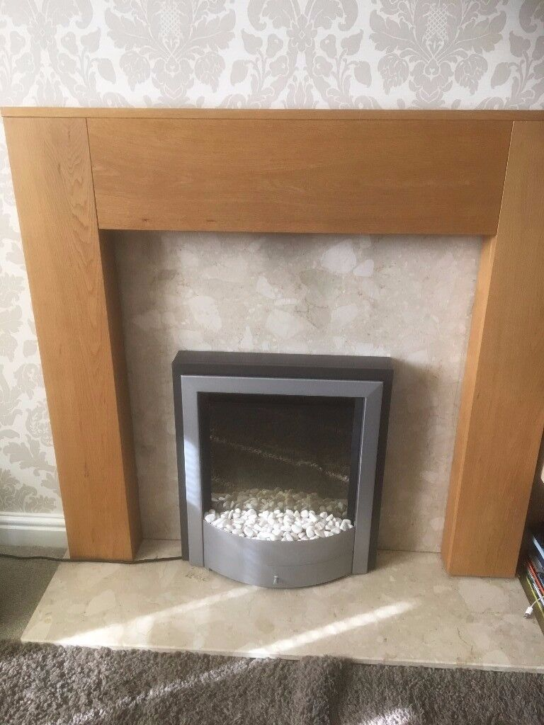 marble hearth and back plate with hardwwod surround