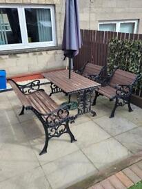 Cast iron and wood table and chairs