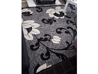 2 Black and white rugs