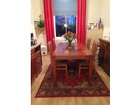 Solid wood dining table, beautiful wood dining table, large can seat 6 - 8 people, lovely condition.