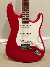 1991 Fender USA American Standard Stratocaster Candy Apple red with rosewood fretboard.