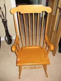 solid wood rocking chair in excellent condition