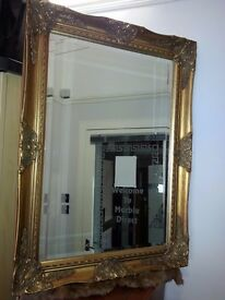 antique. lovely gold colour frame mirror
