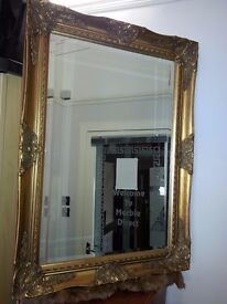 antique. lovely gold colour frame mirror