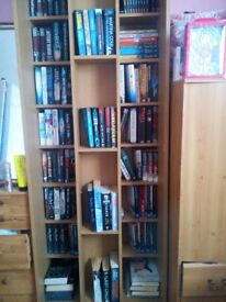 Pine bookcase including all books