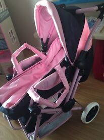 Pink and navy doll pram