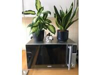 *House clearance* Stainless steel microwave oven* Delonghi* Barely used*