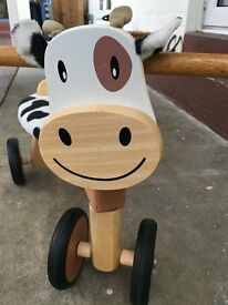 Wooden cow bike for toddler