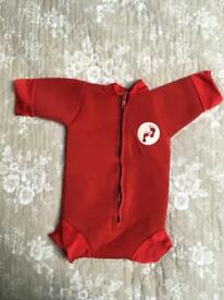 Two bare feet newborn baby wetsuits