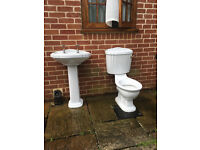 White washbasin and matching toilet, with very nice taps and connectors