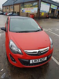 RED LIMITED ADDITION VAUXHALL CORSA 1.2 LITRE PETROL.