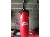 Leather punch bag and bracket