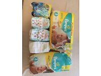 88 pampers nappies size 3, 13 Aldi nappies plus bag of little swimmers