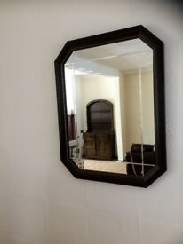 2 matching wall mirrors in dark wood