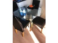 Glass dining table and 4 chairs.